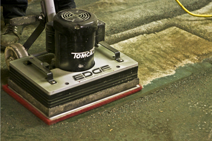 Tomcat EDGE® Floor Scrubber with an Abrader Plate tearing up Old Floor Paint