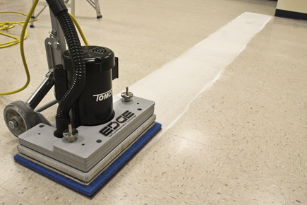 Tomcat EDGE® Floor Scrubber stripping off floor finish on VCT flooring