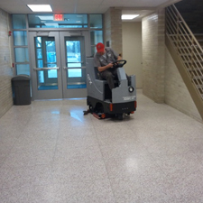 GTX Rider Floor Scrubber Cleaning the Inside of a School