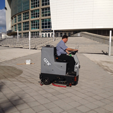 GTX Rider Floor Scrubber Cleans the Outside Enterance of a Corporate Headquaters