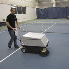 34 Walk Behind Floor Sweeper cleaning up cement