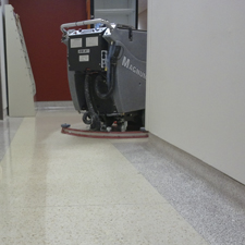 Magnum Floor Scrubber Scrubbing a Lunch Room