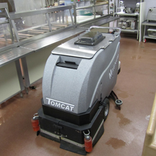 Magnum Floor Scrubber Dryer Scrubbing a Lunch Room