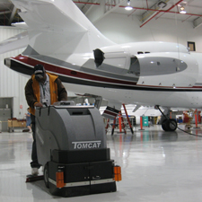 Magnum Floor Scrubber In an Airplane Hangar