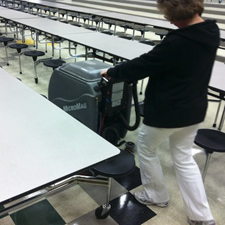MicroMag Floor Scrubber Fits into the Tight Isles Between Small Lunchroom Tables
