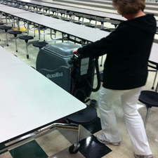 MicroMag Scrubber Dryer Fits into the Tight Isles Between Small Lunchroom Tables