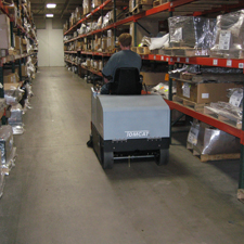 TR Floor Sweeper Cleaning up a Warehouse