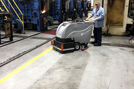 Magnum Floor Scrubber Dryer Cleaning Concrete Floors in a Factory