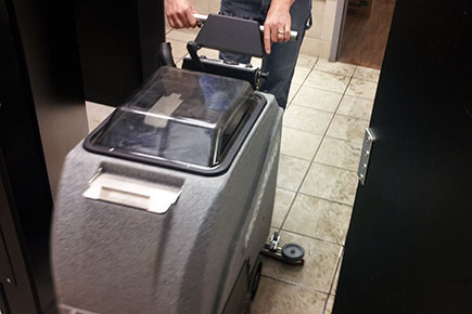 MicroMag Floor Scrubber Dryer Easily Fits Into Bathroom Stall To Clean