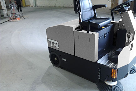 TR Rider Sweeper Cleaning Concrete Floor